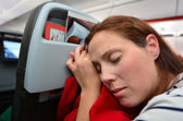 Woman sleep during flight — Stock Photo