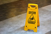 Slippery floor surface warning sign  and symbol — Stock Photo