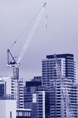 Tower crane in new building construction site — Stock Photo