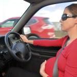 Pregnant woman drive a car — Stock Photo #48069915
