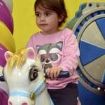 Little girl ride on carousel horse — Stock Photo #48171793