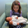 Little girl and newborn sister — Stock Photo #48520137
