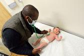Doctor checks newborn baby — Stock Photo