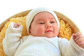 Baby girl lying down in basket — Stock Photo