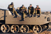 Israeli soldiers on armed vehicle — Stock Photo