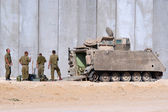 Israeli soldiers outside armed vehicle — Stock Photo