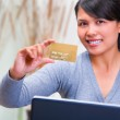Showing gold credit card — Stock Photo #11064749