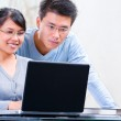 Couple browsing internet at home — Stock Photo #11064849