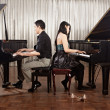 Stock Photo: Duet with pianos
