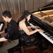 Duet with pianos — Stock Photo #24532189