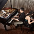 Duet with pianos — Stock Photo #24532335