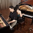 Duet with pianos — Stock Photo