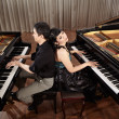 Duet with pianos — Stock Photo #24548021