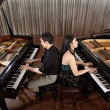 Duet with pianos - Stock Photo