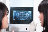 Examining teeth X Ray — Stock Photo