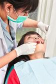 Dentist examing teeth — Stock Photo