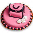 Birthday cake with pink frosting,decorated with a woman handbag - Stock Photo