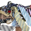 Bunch of colored ties against white background. - Stock Photo
