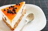 Orange jelly cake with mousse and cranberries on top. — Stock Photo