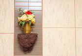 Ornamental color flowers in the bathroom — Stock Photo