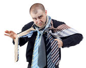 Angry man choosing the perfect necktie — Stock Photo