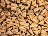 Closeup of well stacked firewood usable as texture. — Stock Photo