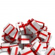 Stock Photo: Falling white gift boxes with red ribbon