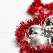 Stockfoto: Christmas arrangement with silver baubles and red garland