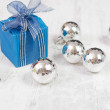 Christmas arrangement with bue gift box and silver baubles — Stock Photo