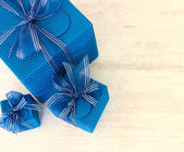 Three blue carton gift boxes — Stock Photo