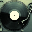 Top view of old fashioned turntable playing a track — Stock Photo #21756989
