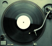 Top view of old fashioned turntable playing a track — Stok fotoğraf