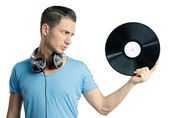 Young male holding black vinyl in hand — Stock Photo