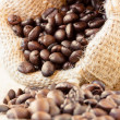 Roasted coffee beans in jute bag — Stock Photo