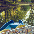 Blue boat on lake in autumn season — Stock Photo