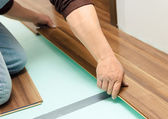 Man laying parquet in clean room — Stock Photo