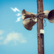 Wooden pole with three speakers — Stock Photo