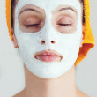 Woman having a white smoothing face mask — Stock Photo #30335979