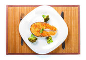 Salmon meat with delicious broccoli on white plate — Stock Photo