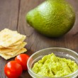 Avocado cream,biscuits and small tomatoes — Stock Photo