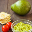 Stock Photo: Avocado cream,biscuits and small tomatoes