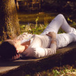 Stock fotografie: Womwith eyes closed relaxing on bench in nature