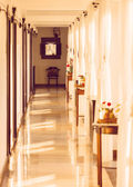 Long nicely styled vintage hotel corridor — Stock Photo