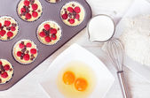 Top view of unripe muffins with ingredients — Stock Photo