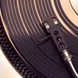 Top view of old fashioned turntable playing a track — Stock Photo #47247095