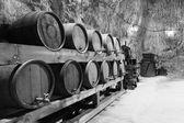 Old wine barrels in a salt mine — Stock Photo