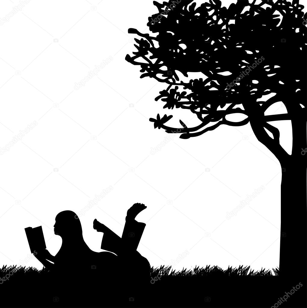 Silhouette of girl reading a book under the tree in spring ...