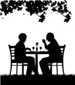 Lovely retired elderly couple having a romantic dinner silhouette — Stock Vector