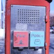 Emergency Reporting System box with buttons to notify the police and fire department - Stock Photo