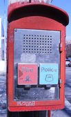 Emergency Reporting System box with buttons to notify the police and fire department — Stok fotoğraf